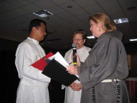 Fr. Arturo+ and Sara confirming new bishops-elect