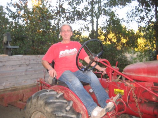 Brother Ray on the tractor during our work week