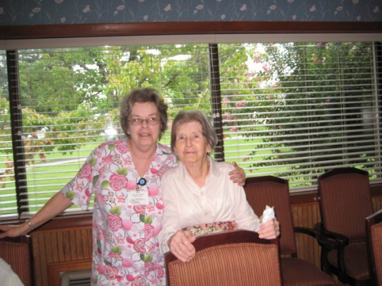 Mom and a staff member at Assisted Living