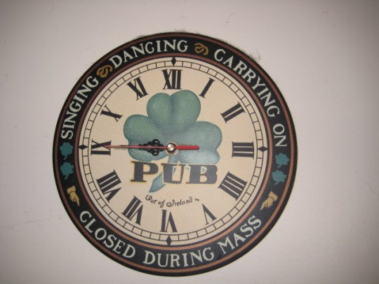 Clock over the bar at St. Junia's House