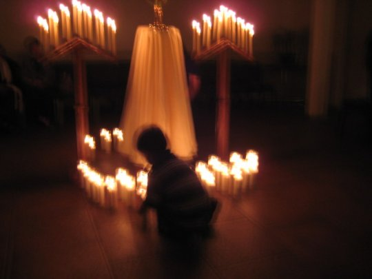 Mark placing a candle at the Blessed Sacrament