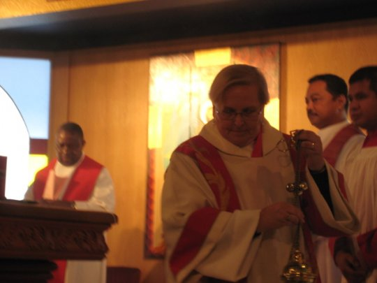 Deacon Pam censing at the Mass on Pentecost, 2011