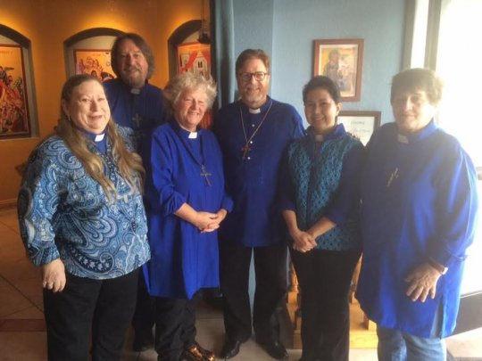 Clergy after Mass wearing Advent Blue